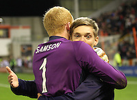 Thomas Reilly hugs Craig Samson after getting to the semi final in the Aberdeen v St Mirren Scottish Communities League Cup match played at Pittodrie Stadium, Aberdeen on 30.10.12.