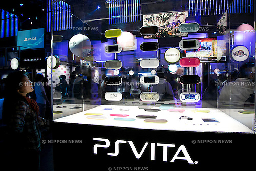 A visitor sees a picture the PSVITA consoles at Tokyo Game Show,  September 20, 2013. The Tokyo Game Show one of the world's biggest trade show for video game developers brings exhibitors from 33 different countries and regions, 352 companies and organizations, opens from September 19 to 22 at the International Convention Complex Makuhari Messe in Chiba. (Photo by Rodrigo Reyes Marin/AFLO)