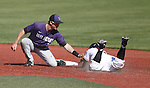 Austin Fisher applies tag to stealing OSU player Jake Rodriguez. Kansas State vs. Oregon State at NCAA Super Regional in Corvallis, Oregon on June 8, 2013.  Photo by Steve Dipaola