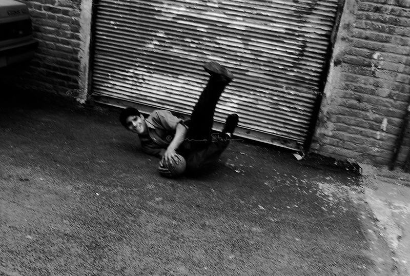 Teheran, Iran, April 17, 2007.Mehdi stops a ball in an old city alley way..