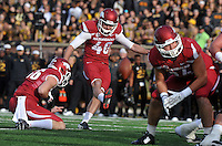 NWA Media/Michael Woods --11/28/2014-- w @NWAMICHAELW...University of Arkansas kicker Adam McFain kicks an extra point in the 2nd quarter of Friday afternoons game against Missouri at Faurot Field in Columbia Missouri.