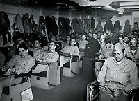 VB-85 SB2C Helldiver pilots and air crewman (rear seat gunners) are briefed in the ready room of the USS Shangri-La before a mission during the final days of WWII. Mission was called off due to a typhoon. -  Aug. 12, 1945
