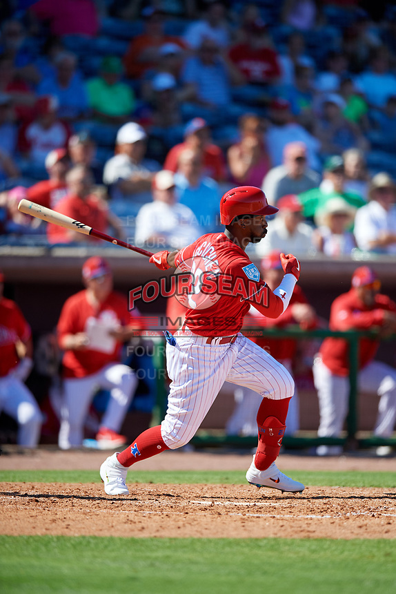 Philadelphia Phillies left fielder Andrew McCutchen (22) follows through on a swing during a Grapefruit League Spring Training game against the Baltimore Orioles on February 28, 2019 at Spectrum Field in Clearwater, Florida.  Orioles tied the Phillies 5-5.  (Mike Janes/Four Seam Images)