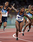 8/27/04 --Al Diaz/Miami Herald/KRT--Athens, Greece--Athletics at the Olympic Stadium during the Athens 2004 Olympic Games. USA's Marion Jones fails to exchange the baton to teammate Lauryn Williams in the  Women 4 x 100m Relay Final. ( 2of 7)