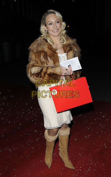 Kristina Rihanoff.The English National Ballet - Nutcracker gala performance, London Coliseum, St Martin's Lane, London, England..December 13th, 2012.full length  red goody bag brown fur jacket white dress boots  .CAP/CAN.©Can Nguyen/Capital Pictures.