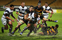 Auckland's Taniela Moa is brought down. Air New Zealand Cup rugby match - Taranaki v Auckland at Yarrows Stadium, New Plymouth, New Zealand. Friday 9 October 2009. Photo: Dave Lintott / lintottphoto.co.nz