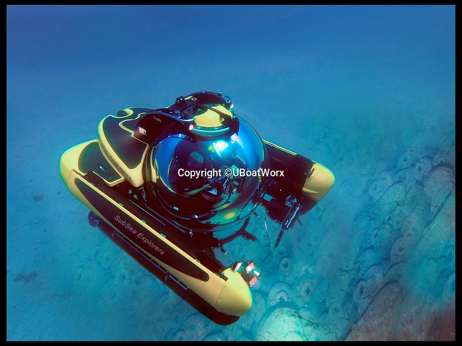 BNPS.co.uk (01202 558833)<br /> Pic: UBoatWorx/BNPS<br /> <br /> *Please use full byline*<br /> <br /> Explorer underwater.<br /> <br /> A travel company has launched the ultimate in tourist day trips - visiting never-seen-before Roman shipwrecks 500ft below the surface in a James Bond-style submarines.<br /> <br /> For the first time ever adventurous daytrippers are being given the chance to join a marine archaeology expedition to research the newly-discovered 2,000-year-old wrecks off the coast of Sicily.<br /> <br /> But grockles wanting to join the pioneering mission will need deep pockets - because prices for the trip start at &pound;15,000 and go up to an eye-watering &pound;160,000.