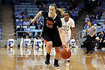 16 December 2014: Oregon State's Ali Gibson (14) is chased by North Carolina's Brittany Rountree (11). The University of North Carolina Tar Heels hosted the Oregon State University Beavers at Carmichael Arena in Chapel Hill, North Carolina in a 2014-15 NCAA Division I Women's Basketball game. Oregon State won the game 70-55.