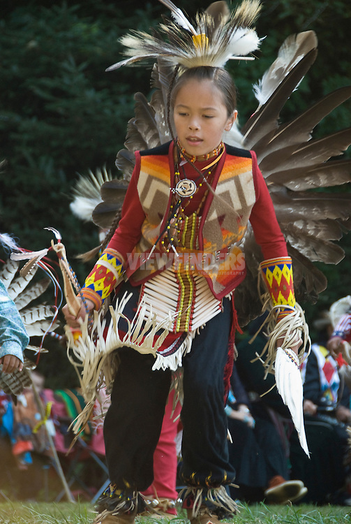 Young boy in traditional costume demonstrates a native American dance at the Depoe Bay Salmon Bake, Depoe Bay, Oregon