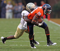 Sept. 3, 2011 - Charlottesville, Virginia - USA; Virginia Cavaliers wide receiver Tim Smith (20) is tackled by William & Mary Tribe cornerback B.W. Webb (2) during an NCAA football game at Scott Stadium. Virginia won 40-3. (Credit Image: © Andrew Shurtleff