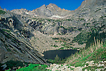 A summer view of Black Lake and McHenry's Peak in Rocky Mountain National Park, Colorado.