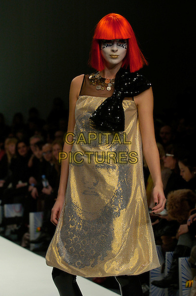 MODEL.The Autumn / Winter 2007 collection of Indian designer Manish Arora at London Fashion Week (LFW), London, UK..February 12th, 2007.runway catwalk wig half length dress make up make-up makeup black gold dress bow print.CAP/CAN.©Can Nguyen/Capital Pictures