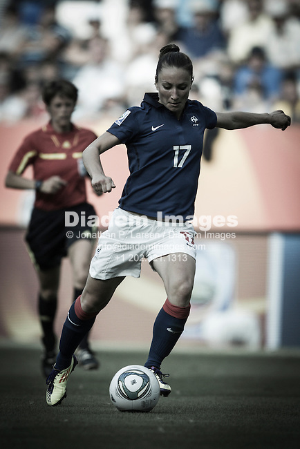 SINSHEIM, GERMANY - JULY 16:  Gaetane Thiney of France in action during the 2011 FIFA Women's World Cup third place match against Sweden at Rhein Neckar Arena on July 16, 2011 in Sinsheim, Germany.  Editorial use only.  No push to mobile device usage.  Commercial use prohibited.   Editor's note:  image color digitally desaturated.  (Photograph by Jonathan P. Larsen / Diadem Images)