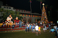 Christmas comes to Hawaii wth the annual lighting of the Christmas tree in the Honolulu Hale courtyard attracting local families and tourists alike.  Located in downtown Honolulu.