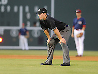 Umpire Sean Ryan officiates a game between the Greenville Drive and Hickory Crawdads on Friday, August 31, 2012, at Fluor Field at the West End in Greenville, South Carolina. Greenville won, 7-2. (Tom Priddy/Four Seam Images)