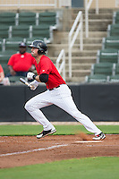 Louie Lechich (21) of the Kannapolis Intimidators follows through on his swing against the Hickory Crawdads at CMC-Northeast Stadium on April 17, 2015 in Kannapolis, North Carolina.  The Crawdads defeated the Intimidators 9-5 in game one of a double-header.  (Brian Westerholt/Four Seam Images)