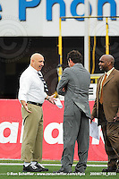 July 18, 2009; Hamilton, ON, CAN; Winnipeg Blue Bombers head coach Mike Kelly speaks with TSN sportcaster Rod Black and TSN game analyst Duane Forde, right, prior to the game against the Hamilton Tiger-Cats. CFL football: Winnipeg Blue Bombers vs. Hamilton Tiger-Cats at Ivor Wynne Stadium. The Tiger-Cats defeated the Blue Bombers 25-13. Mandatory Credit: Ron Scheffler. Copyright (c) 2009 Ron Scheffler.