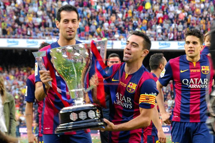 League BBVA 2014/2015. Game: 38.<br /> FC Barcelona vs Deportivo: 2-2.<br /> Sergio Busquets, Xavi Hernandez &amp; Marc Bartra.