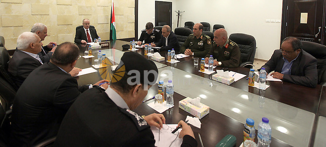 A handout picture released by Prime Minister Office shows Palestinian Prime Minister Rami Hamdallah chairs a meeting with security chiefs, in the West Bank city of Ramallah on April 6, 2015. Photo by PMO