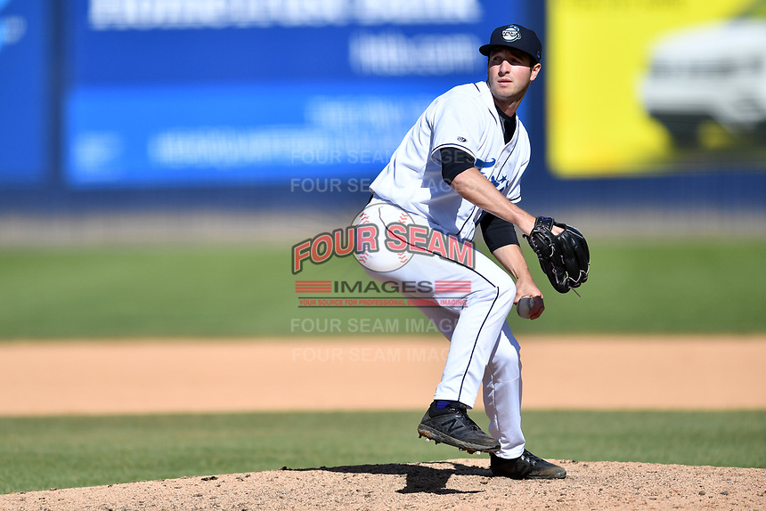 Asheville Tourists pitcher PJ Poulin (15) delivers a pitch during a game against the Delmarva Shorebirds at McCormick Field on May 5, 2019 in Asheville, North Carolina. The Shorebirds defeated the Tourists 10-9. (Tony Farlow/Four Seam Images)