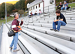 "Newell talks to high school student Troy Woods before the football game on Friday, Oct. 11, 2013 in Hyden, Ky. Newell can hardly go anywhere without seeing someone he knows. ""He's  a friend,"" said Woods. ""He's just in the community so much."" Photo by Tessa Lighty"