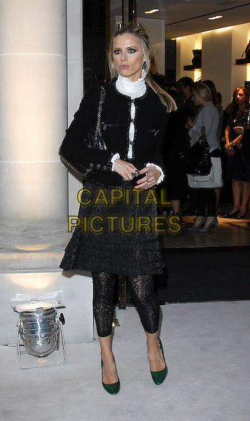 LAURA BAILEY.Vogue 'Fashion's Night Out ' launch at Burberry's store in New Oxford Street, London, England..September 10th 2009.full length black jacket leggings lace dress skirt green shoes heels white high collar.CAP/ROS.©Steve Ross/Capital Pictures.