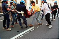 Big fight between demonstrators and Italian police during the protest against the G8 Summit in Genova on July 2001..L'allora vice capo della Digos di Genova, Alessandro Perugini (in maglia gialla) durante il pestaggio di un giovane manifestante