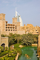 Dubai.   Al Qasr Hotel, Malakiya Villas and Burj al Arab Hotel seen over the Madinat Jumeirah. .