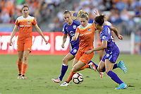 Houston, TX - Saturday June 17, 2017: Kealia Ohai dribbles the ball between Rachel Hill and Kristen Edmonds during a regular season National Women's Soccer League (NWSL) match between the Houston Dash and the Orlando Pride at BBVA Compass Stadium.