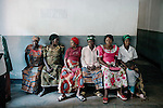 BUSHUSHU, DEMOCRATIC REPUBLIC OF CONGO - NOVEMBER 1: Unidentified pregnant women waits to be attended to in a rural clinic in Bushushu, about five hours drive from Bukavu, DRC. Many of these women has been raped and abused by rebels and government soldiers. About 10 women and girls show up at the hospital every day and Dr. Denis Mukwege, a gynecologist and his staff does up to 20 reconstructive operations every day. He often has to perform complicated surgery to reproductive and digestive parts of the women. The DRC conflict has seen an unprecedented high rate of rape and sexual abuse of women. The culprits are both different rebel groups and government soldiers and very few are punished. About 27,000 sexual assaults were reported in South Kivu province alone in 2006, according to the United Nations. (Photo by Per-Anders Pettersson).