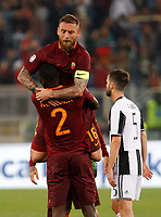 Calcio, Serie A: Roma vs Juventus. Roma, stadio Olimpico, 14 maggio 2017. <br /> Roma's Daniele De Rossi, top, hugs his teammate Antonio Ruediger as Juventus' Miralem Pjanic, right, leaves the pitch at the end of the Italian Serie A football match between Roma and Juventus at Rome's Olympic stadium, 14 May 2017. Roma won 3-1.<br /> UPDATE IMAGES PRESS/Riccardo De Luca