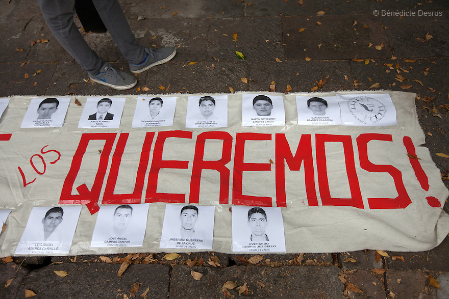 "Parents and relatives of the 43 missing students from Ayotzinapa's teacher training college hold ia banner saying ""Vivos se los llevaron, Vivos los queremos"" (they were taken alive, we want them back alive) during a march in Morelia, Michoacan, Mexico on November 19, 2014. The relatives of the 43 missing students still do not believe the official line that the young men are all dead, and with classmates, social organizations and human rights defenders, they started on Thursday a national caravan. They split up into three different caravans, branching out to share information face to face with supporters in other cities and rally nationwide support. The three groups will meet in Mexico City on Thursday 20 for a general strike and massive marches to demand justice and fight against corrupted government and organized crime. Criticism of the government has intensified in Mexico, and many are demanding that the search for the 43 missing students continue until there is concrete evidence to the contrary. (Photo by Bénédicte Desrus)"