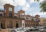 White taxis outside historic railway station building, Jerez de la Frontera, Spain