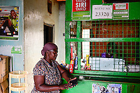 KENIA, County Siaya, village Kotanega, M-Pesa payment by mobile phone / KENIA, bezahlen per Mobiltelefon, M-Pesa von Safari.com a joint venture of Vodafone and kenyan telephone