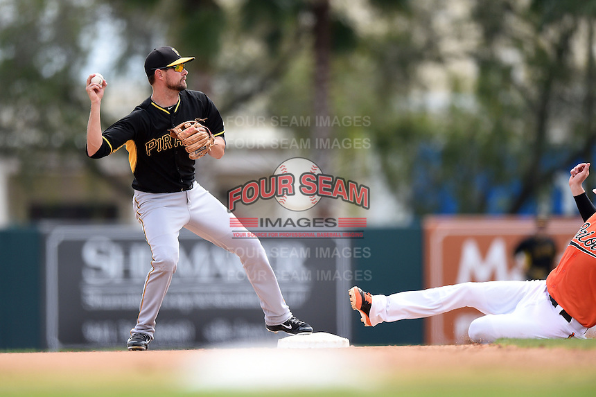 Shortstop Jordy Mercer (10) of the Pittsburgh Pirates during a spring training game against the Baltimore Orioles on March 23, 2014 at McKechnie Field in Bradenton, Florida.  Baltimore and Pittsburgh played to a 7-7 tie.  (Mike Janes/Four Seam Images)