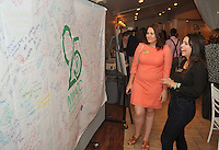 NWA Democrat-Gazette/MICHAEL WOODS • @NWAMICHAELW<br /> Northwest Arkansas Community College students Tanya Castella (left) and Leticia Zark De Campos look at the student signatures on a banner signed by hundreds of students to commemorate the 25th year of the college during a reception Thursday September 17, 2015 at the Avondale Chapel and Gardens in Bentonville.  Guests at the reception included current and former trustees, elected officials and longtime college faculty and staff members. College President Evelyn Jorgenson, board chairman Ric Clifford and former trustee and current NWACC Foundation Board member Dick Trammel will spoke during the event Guests also had a chance to see memorabilia and artifacts from the college's early years.