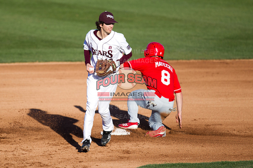 Kevin Medrano (13) of the Missouri State Bears heads towards the dugout after getting the force out at second base during a game against the Southern Illinois University- Edwardsville Cougars at Hammons Field on March 9, 2012 in Springfield, Missouri. (David Welker / Four Seam Images)