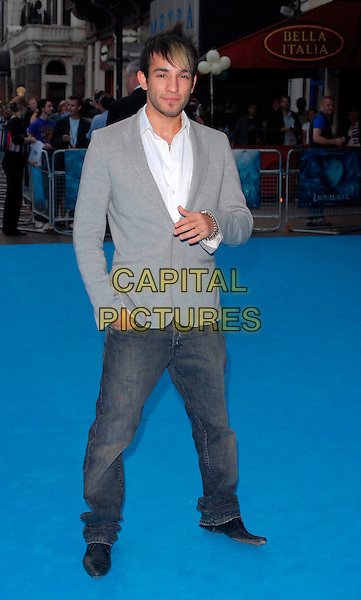 """SEZER YURTSEVEN.""""Lady In The Water"""" - UK film Premiere, Vue West End, London, UK..August 8th, 2006.Ref: CAN.full length grey gray suit jacket jeans denim big brother.www.capitalpictures.com.sales@capitalpictures.com.©Can Nguyen/Capital Pictures"""
