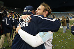 15 December 2013: Notre Dame's Patrick Wall (right) and head coach Bobby Clark (SCO) (left) embrace after the game. The University of Maryland Terripans played the University of Notre Dame Fighting Irish at PPL Park in Chester, Pennsylvania in a 2013 NCAA Division I Men's College Cup championship match. Notre Dame won the game 2-1.