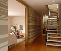 The main wall in the hallway features hand-painted horizontal stripes of varying widths