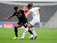 Lincoln City's Liam Bridcutt battles with Milton Keynes Dons' David Kasumu<br /> <br /> Photographer Chris Vaughan/CameraSport<br /> <br /> The EFL Sky Bet League One - Milton Keynes Dons v Lincoln City - Saturday 19th September 2020 - Stadium MK - Milton Keynes<br /> <br /> World Copyright © 2020 CameraSport. All rights reserved. 43 Linden Ave. Countesthorpe. Leicester. England. LE8 5PG - Tel: +44 (0) 116 277 4147 - admin@camerasport.com - www.camerasport.com