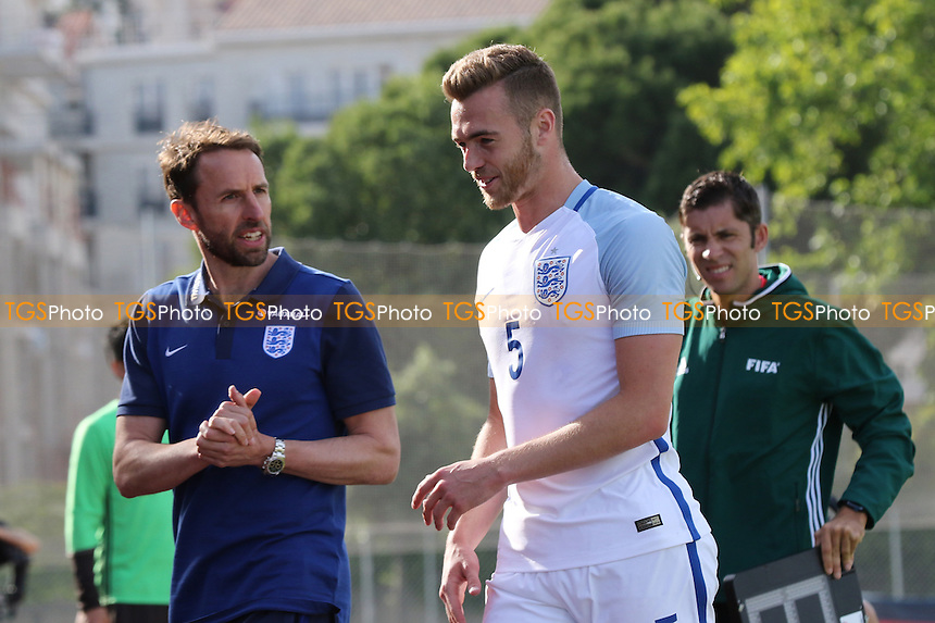 England Manager, Gareth Southgate, has a chat with Arsenal's Calum Chambers after he was substituted in the second half during Japan Under-20 vs England Under-20, 2016 Toulon Tournament Football at Stade Leo Lagrange on 27th May 2016