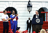 United States President George H.W. Bush, right, makes remarks as he and first lady Barbara Bush kick-off the Great American Workout Month with Arnold Schwarzenegger, left, and US Secretary of Health and Human Services Louis Sullivan, center, on the South Lawn of the White House in Washington, D.C. on May 1, 1990.<br />
