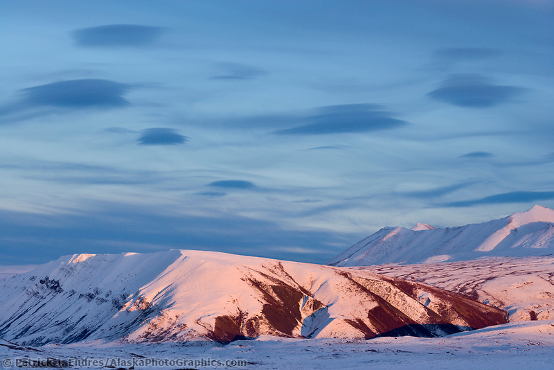 Lenticular clouds over the Philip Smith Mountains of the Brooks Range, Arctic, Alaska