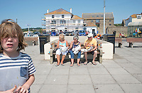 Eating lunch on a Summer day at West Bay, Brid Port, Dorset, UK.