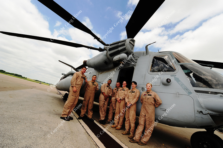 The flight crew poses with the CH-53 marine helicopter. The pilot is Wisconsin native Major Jodi (Miller) Maroney, US Marine Corps (standing third from right)