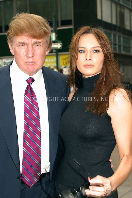 Donald Trump and girlfriend Melania Knauss arrive in Bryant Park during New York Fashion Week. New York, September 18, 2002. Please byline: Alecsey Boldeskul/NY Photo Press.   ..*PAY-PER-USE*      ....NY Photo Press:  ..phone (646) 267-6913;   ..e-mail: info@nyphotopress.com....Giselle