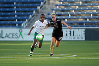 Red Stars midfielder Formiga (8) battles for the ball with FC Gold Pride midfielder Becky Edwards (14).  The FC Gold Pride defeated the Chicago Red Stars 3-2 at Toyota Park in Bridgeview, IL on August 22, 2010