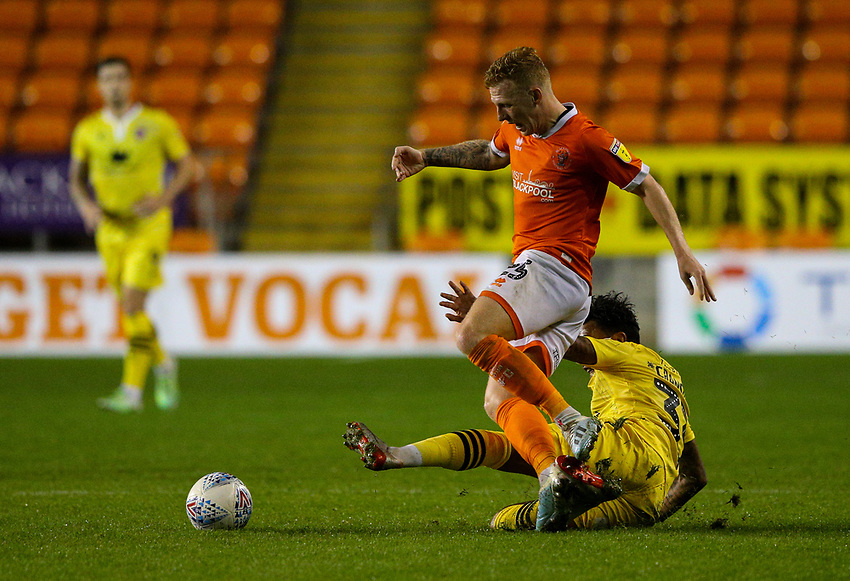 Blackpool's Callum Guy is tackled by Morecambe's Jordan Cranston<br /> <br /> Photographer Alex Dodd/CameraSport<br /> <br /> EFL Leasing.com Trophy - Northern Section - Group G - Blackpool v Morecambe - Tuesday 3rd September 2019 - Bloomfield Road - Blackpool<br />  <br /> World Copyright © 2018 CameraSport. All rights reserved. 43 Linden Ave. Countesthorpe. Leicester. England. LE8 5PG - Tel: +44 (0) 116 277 4147 - admin@camerasport.com - www.camerasport.com