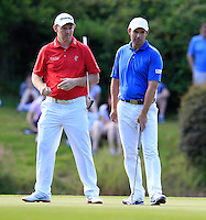 Stephen Gallacher (SCO) and Padraig Harrington (IRL) on the 18th green during Friday's Round 2 of the 2014 Irish Open held at Fota Island Resort, Cork, Ireland. 20th June 2014.<br /> Picture: Eoin Clarke www.golffile.ie